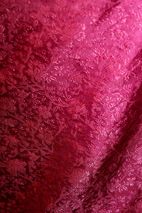 close up of Silk Damask used in the dress.