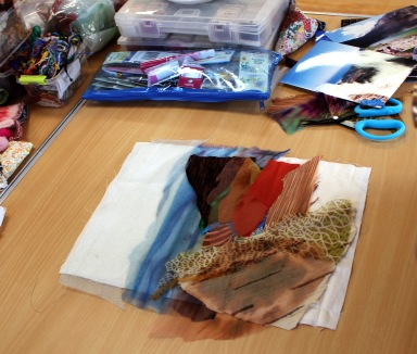 Laying out fabrics to create image.