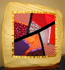 Dabble day crazy patchwork square put to good purpose as a cusin cover.