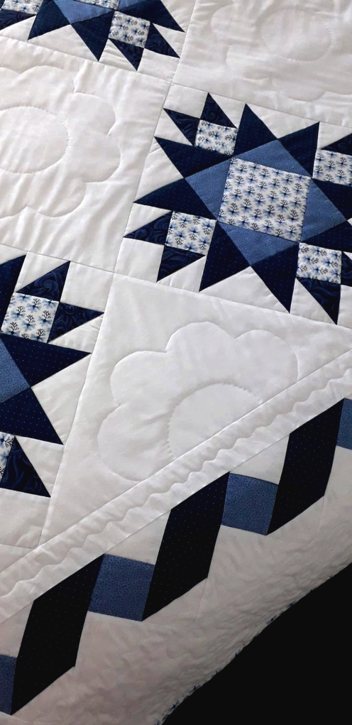 A close up of the quilting design